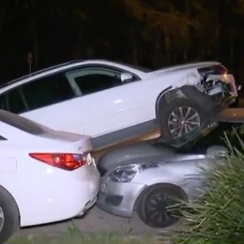 Police Left Stunned After Bizarre Crash Leaves Car On Top Of Another In Sydney's West