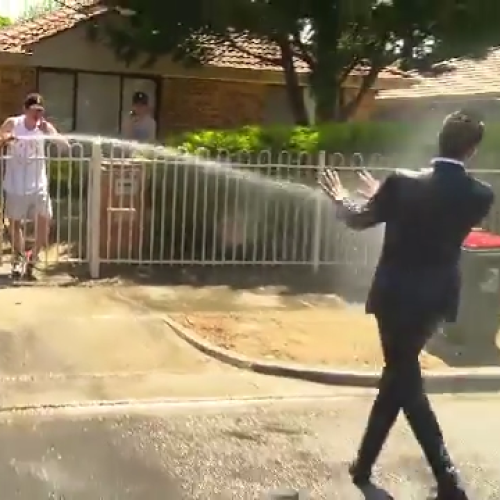 Watch 'A Current Affair' Reporter Get Completely Drenched On National TV